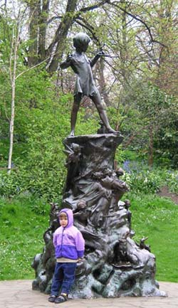 A would-be Peter Pan at the foot of the Peter Pan statue at Hyde Park