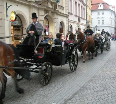 A horse-drawn procession ambles by our cafe