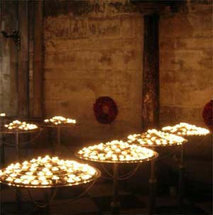 Votive candles inside Notre Dame