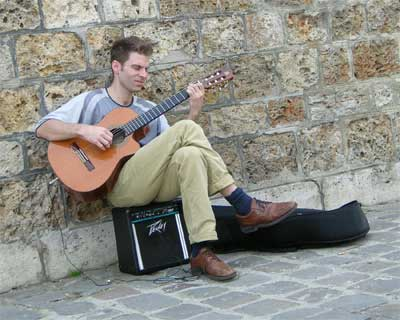 Street musician (nice classical guitar) on the banks of the Seine