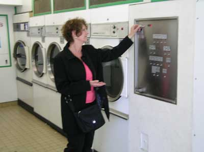 Carol at the laundromat in Bayeaux