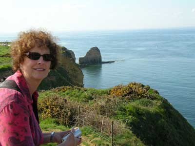 Carol looking at the tall cliffs that our Rangers had to scale at Pont du Hoc