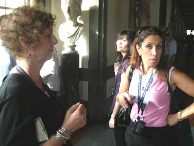 Carol and Fabianna discuss art at the Uffizi