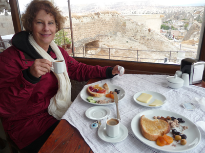 Carol enjoys breakfast at the hotel after our hot-air balloon ride
