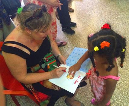 Bonnie autographs her book at the pre-school in Havana