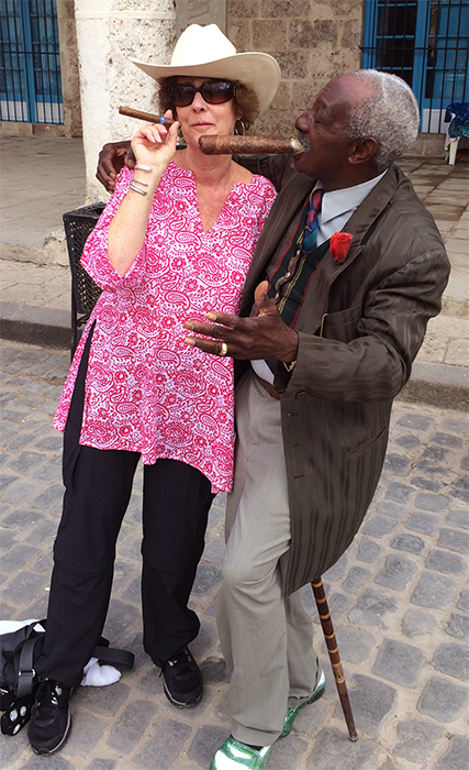 Carol with a character in Old Havana