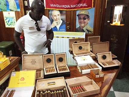 Ramiro contemplates the cigars at the Romeo y Julieta store in Havana