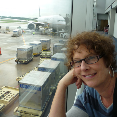 Carol in Houston - our 777 in the background