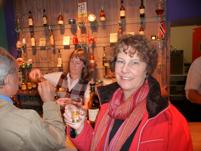 Carol sampling the different flavors of scotch at Glenkinchie Distillery