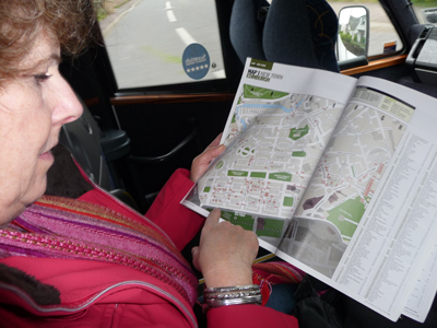 Carol checks the map