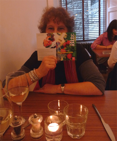 Carol hides behind the menu at Urban Angel in Edinburgh