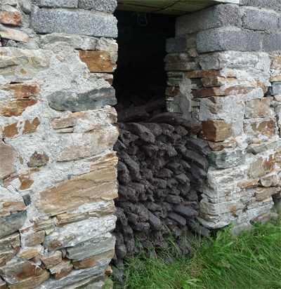 Peat being stored in a stone shed