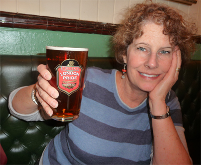 Carol enjoys a pint of London Pride Ale at The Carpenter's Arms pub in Windor