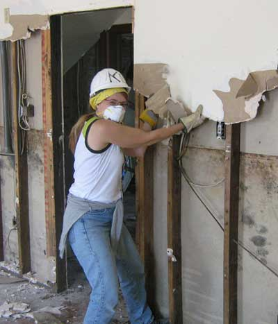 Our friend Marybeth, a volunteer from Toronto,  removing drywall to eliminate mold and prepare for reconstruction