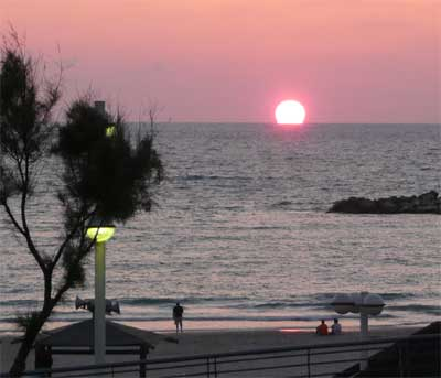 View of the Mediterranean sunset from our Tel Aviv hotel window