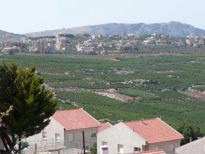 "Looking past the red rooftops of Israel's Matula, across ""No Man's Land,"" into a town on the Lebanese side."