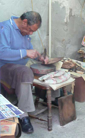 Craftsman at work in a market in Old Acco