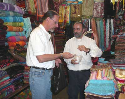 David purchases a scarf at the ancient Jaffa market