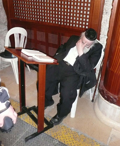 Praying (resting?) at the Western Wall