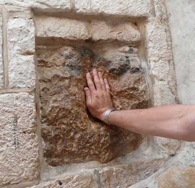 My hand where Jesus touched this wall along the Via Dolorosa