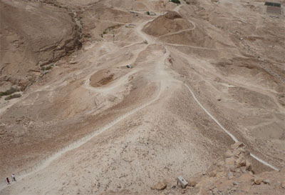Looking down from the top of Masada at the remains of the earthen ramp built by the Romans