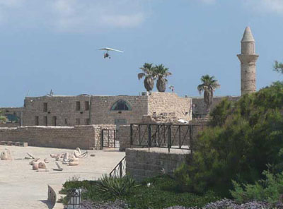 An ultralight plane flying over the ruins at Caesarea
