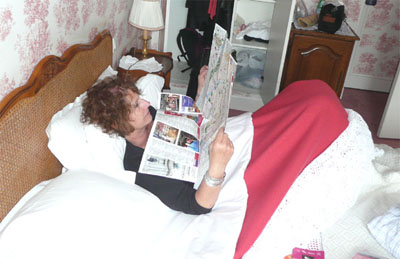 Carol resting at Le Hotel des Grande Ecoles, studying the map for more adventures in Paris