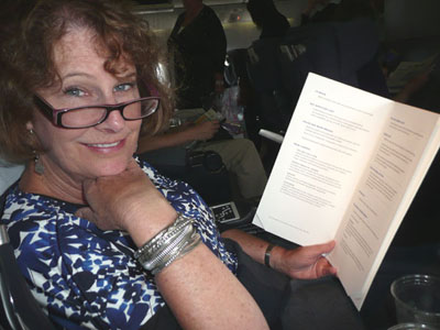 Carol peruses the business-class menu