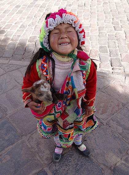 Little girl at the festival in Cuzco