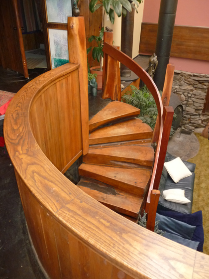 Beautiful hand-crafted wooden spiral staircase descending to a lower level at Bruce Fink's House Of Magic on Pole Bridge Road in Woodstock, Connecticut