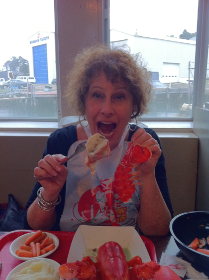 Carol devours a lobster in Boothbay Harbor, Maine