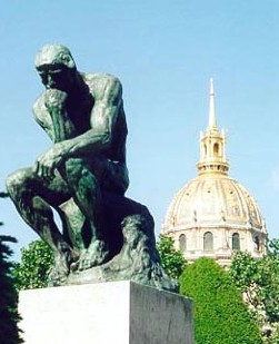 Rodin's The Thinker with the dome of Les Invalides in the background